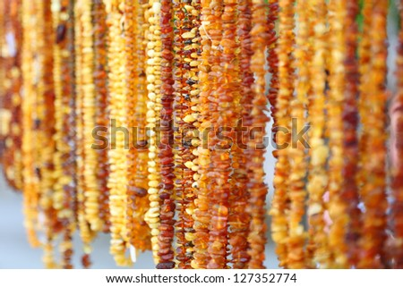 Amber necklace background texture outdoor - stock photo