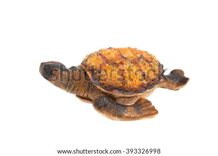 amber turtle isolated closeup. Baltic souvenir - stock photo
