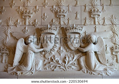 Amboise, France - June 23, 2013: Amboise castle.  Heraldic motifs in the castle Amboise. The current view of the castle was built in 1492 by the will of Charles VIII . Loire Valley, France - stock photo