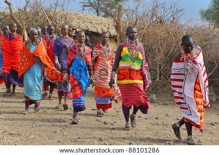 AMBOSELI, KENYA ,OCT. 13:Group of unidentified African women from Masai tribe prepare to show a traditional Jump dance on Oct 13, 2011 in Masai Mara, Kenya. - stock photo