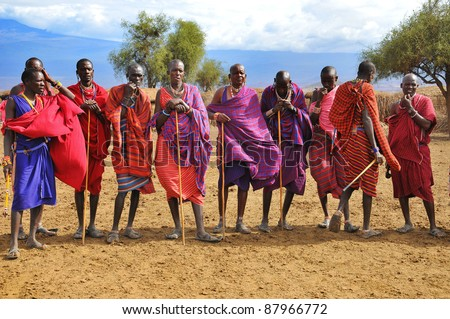 AMBOSELI, KENYA - OCTOBER. 13: Masai warriors dancing traditional jumps as cultural ceremony, review of daily life of local people on October 13, 2011 in Amboseli, Kenya. - stock photo