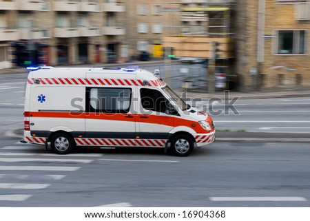 ambulance in action - stock photo