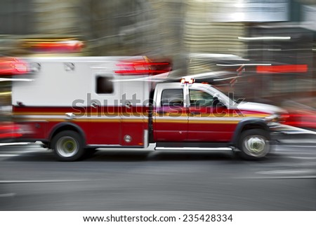 ambulance on emergency call in motion blur - stock photo