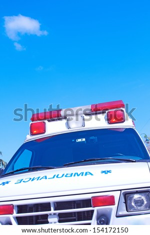 Ambulance with the nice blue sky for copy space - stock photo