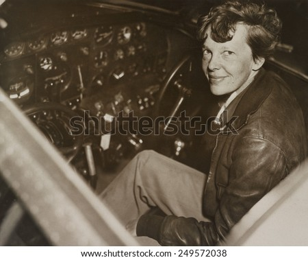 Amelia Earhart sitting in the cockpit of her Lockheed Electra airplane, ca. 1936. In July 1937 Earhart and the airplane were lost over the Pacific Ocean. - stock photo