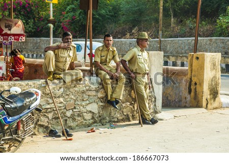 AMER, INDIA - OCT 19: police controls the parking lot on Oct 19, 2012 in Amer, India. Most indish landmarks are protected by police due to fear of terrorist attacs.