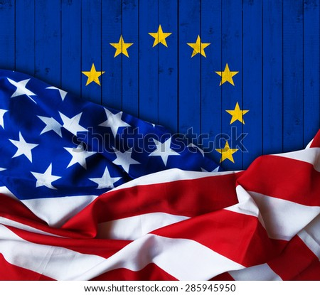 America flag of fabric  and European Union flag of wood - stock photo