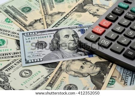 America money, banknote 1,20,100 dollar with calculator - stock photo