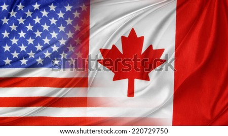 American and Canadian flags together - stock photo