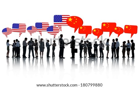 American And Chinese Business Men Shaking Hands - stock photo