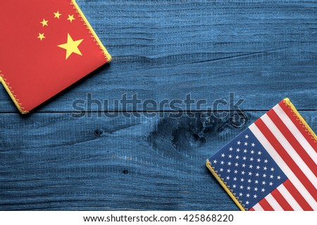 American and Chinese flag on wooden background - stock photo