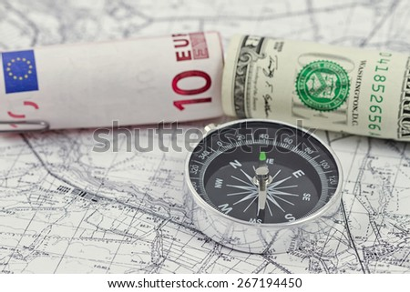 American and European currencies are on the map - stock photo