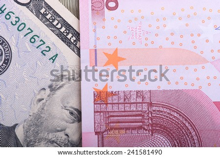 american and european money, dollars and euro - stock photo