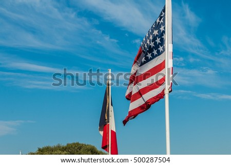 american and french flags in a reconstituted military camp