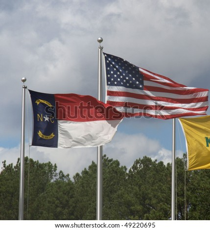 American and North Carolina flags blowing in the breeze.