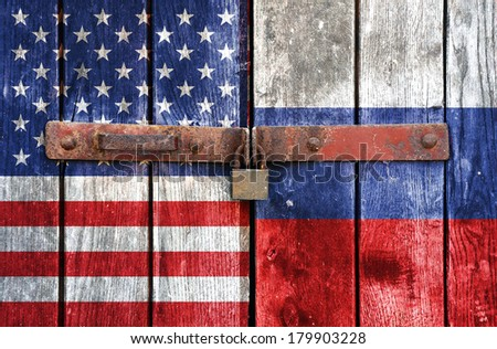 American and Russian flag with padlock doors - stock photo
