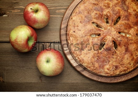 American apple pie on a wooden table, top view - stock photo