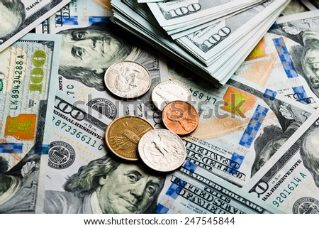 American banknotes and coins  - stock photo