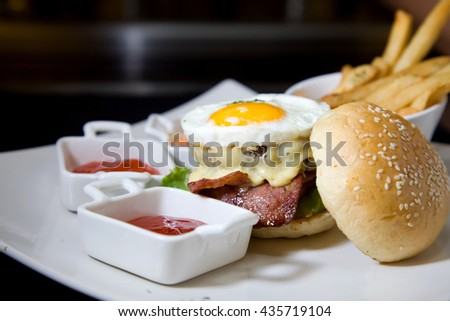 American beef or ham burger with tomato and chili sauce