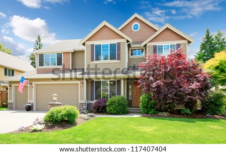 American beige luxury large house front exterior with landscape. - stock photo
