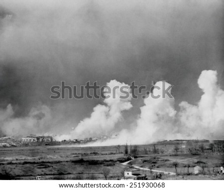 American bombs explode in the town of Cassino, Feb. 15, 1944. The town was completely destroyed but German defenders survived in cellars. The Monte Cassino Abbey was bombed in the same operation. - stock photo