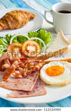 American Breakfast croissant and coffee - stock photo