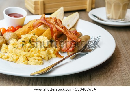American breakfast sausage bacon scrambled eggs hash browns