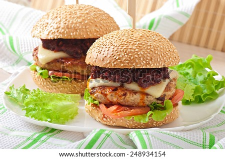 American burger with chicken and bacon, homemade barbecue sauce - stock photo