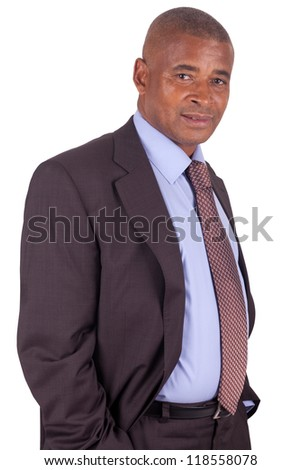 American business man standing on white with hands in pocket - stock photo