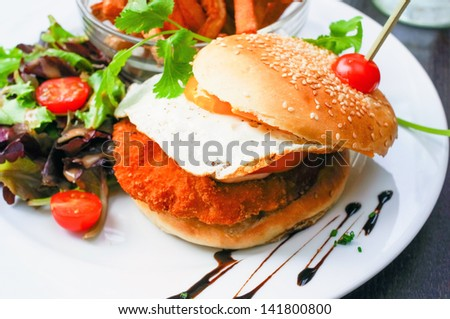 American cheese chicken burger with fresh salad