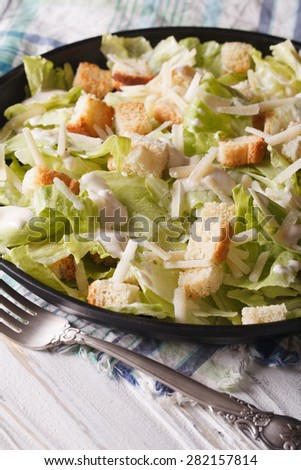 American Classic Caesar Salad close-up on a plate on the table. vertical  - stock photo
