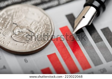 american coin on fluctuating graph. Rate of the dollar (shallow DOF)  - stock photo
