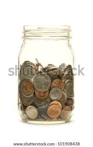 American coins in a glass jar against a white background - stock photo