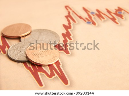 American coins on fluctuating graph with space for copy - stock photo