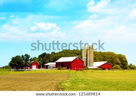 American Countryside Red Farm With Blue Sky - stock photo