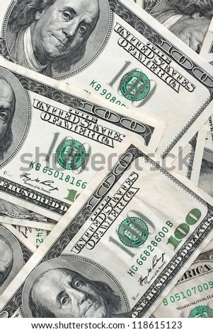 American currency background, notes include $100
