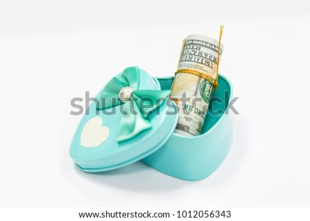 American dollar banknotes on blue box