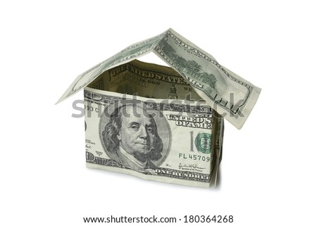 American dollar bills forming a house on white background - stock photo