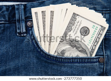 American dollar bills in jeans pocket background - stock photo