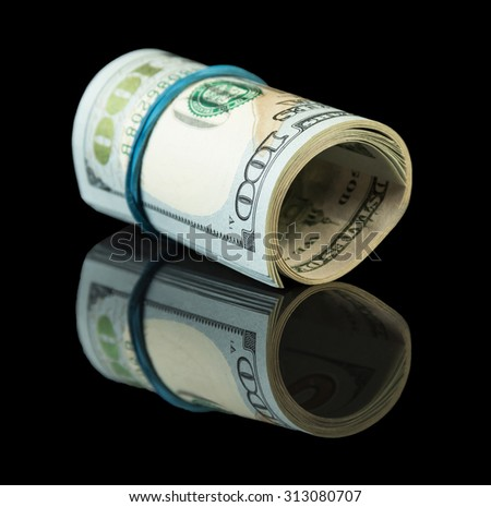 American dollar bills on black background