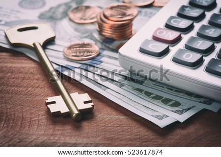 American dollar money, currency and key of safety deposit box. Real estate concept