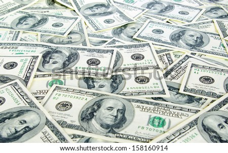 american dollars arranged at the background - stock photo