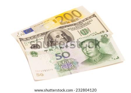 American dollars, European euro and Chinese yuan bills  - stock photo