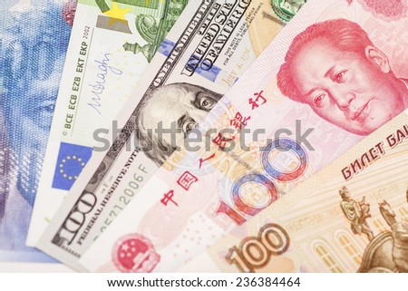 American dollars, European euro,Swiss franc,Chinese yuan and Russian Ruble bills   - stock photo