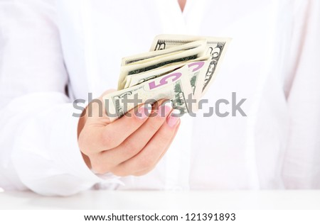 American dollars in a women hands, close up