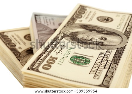 American dollars isolated on white closeup, selective focus - stock photo