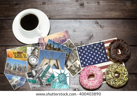 American donuts with napkin in the design of the American flag and white cup of coffee are lying on a wooden desk. Photos from New York City are lying between them. Photo is edited as vintage. - stock photo