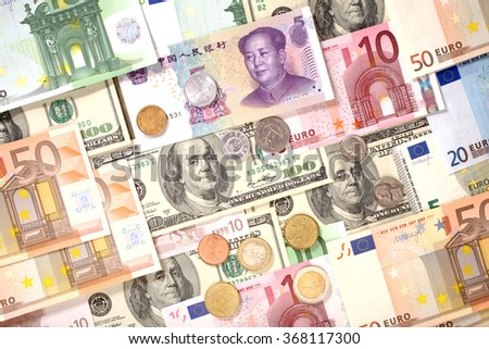 American, European and Chinese banknotes and coins background. Dollars, Euro and Yuan currencies - stock photo