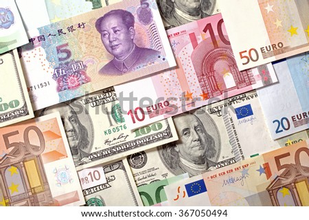 American, European and Chinese banknotes background. Dollars, Euro and Yuan currencies - stock photo