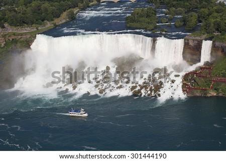 American Falls and cruise boat, Niagara, USA - stock photo